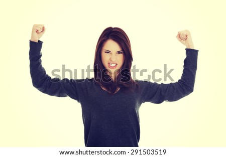 Young woman showing her strength. - stock photo