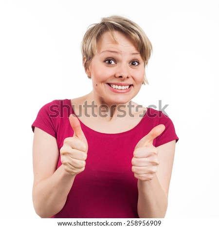 Young woman showing her thumbs up and having a pretty smile, isolated on white - stock photo