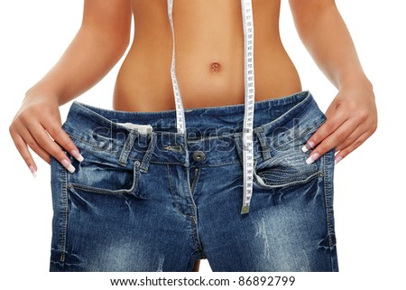 Young woman showing how much weight she lost. Isolated on white - stock photo
