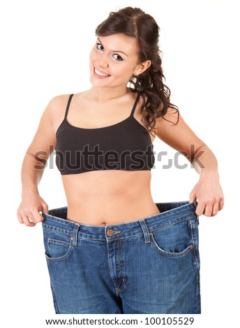 young woman showing how much weight she lost, white background