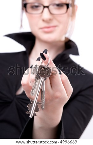 Young woman showing key isolated on white background - stock photo