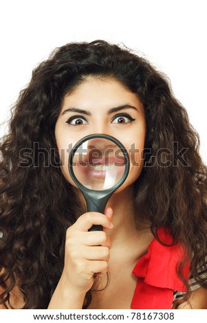Young woman showing lips through magnifying glass - stock photo