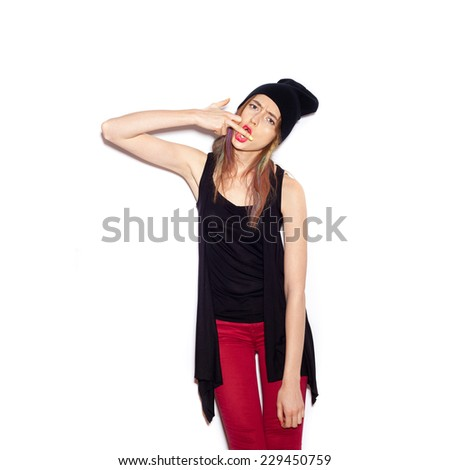 Young woman showing middle finger over white background, not isolated - stock photo