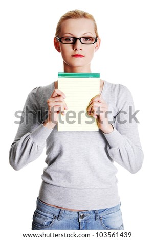 Young woman showing notepad, isolated on white background - stock photo
