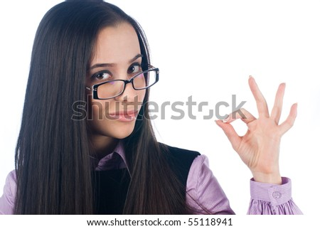 Young woman showing ok sign at white background - stock photo