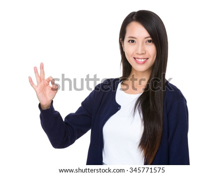 Young woman showing ok sign gesture - stock photo