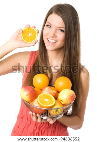 Young woman showing orange fruit at camera