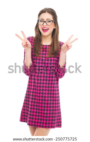 Young woman showing peace sign  - stock photo