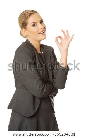 Young woman showing perfect sign - stock photo