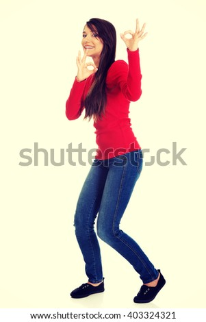 Young woman showing perfect sign. - stock photo