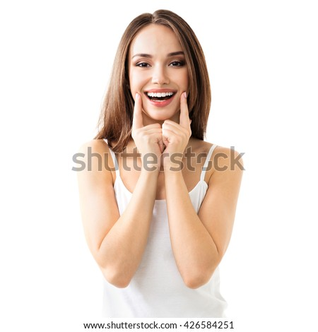 young woman showing smile, in casual smart clothing, isolated against white background - stock photo