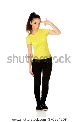 Young woman showing suicide sign. - stock photo