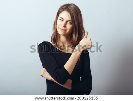 Young Woman Showing Thumb Up - stock photo