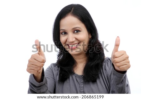 Young woman showing thumb up symbol by two hands
