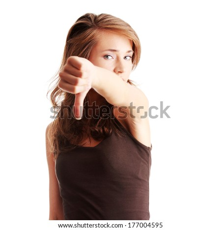 Young woman showing thumbs down isolated  - stock photo