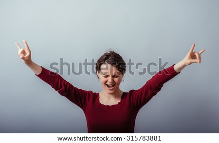 young woman shows a sign of rock