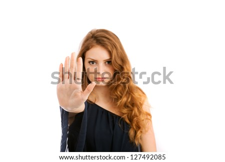 Young woman shows banning hand gesture isolated on white background - stock photo