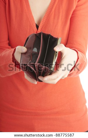 Young woman shows her empty wallet, isolated on white - stock photo