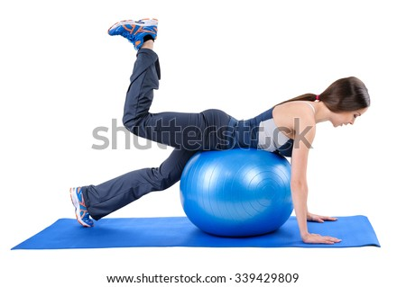 Young woman shows starting position of Fitness Stability Ball Glute Kickback Workout, isolated on white - stock photo