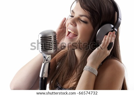 young woman singing in studio - stock photo
