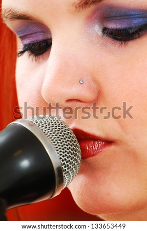 Young woman sings - stock photo