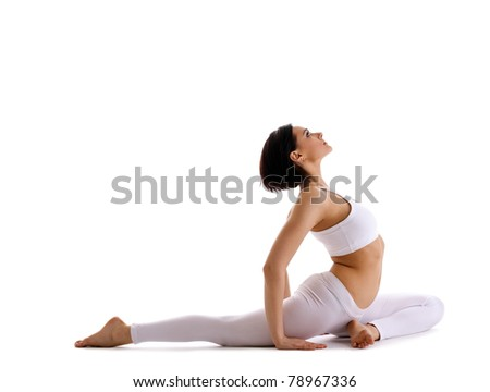 Young woman sit in yoga asana - pigeon pose - stock photo