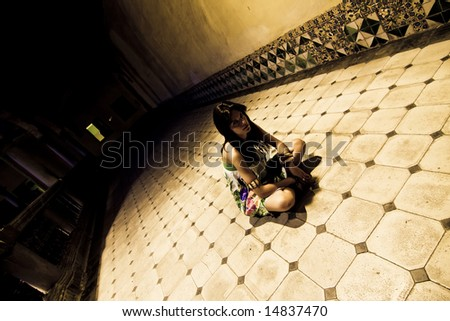 Young woman sited on the sanitarium floor. - stock photo