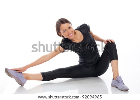 young woman siting in gymnastic pose - stock photo