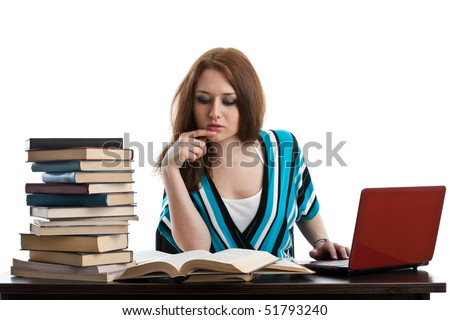 Young woman sitting at a desk   among  books and laptop on a white background. - stock photo