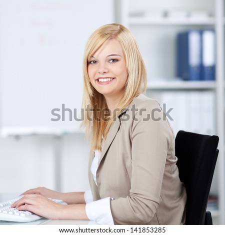 young woman sitting at business desk in the office