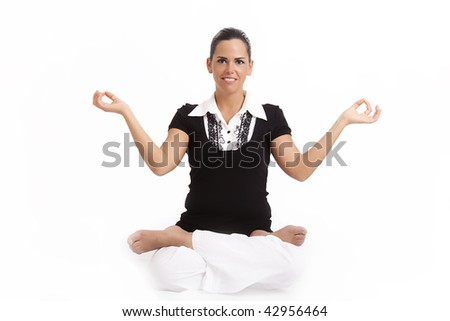 Young woman sitting cross legged and meditating - stock photo