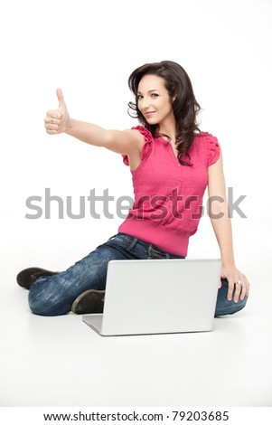 young woman sitting down approving laptop - stock photo