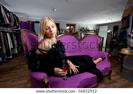 young woman sitting in a boutique