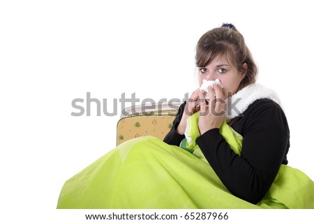 young woman sitting in a chair, having a cold. isolated on white - stock photo