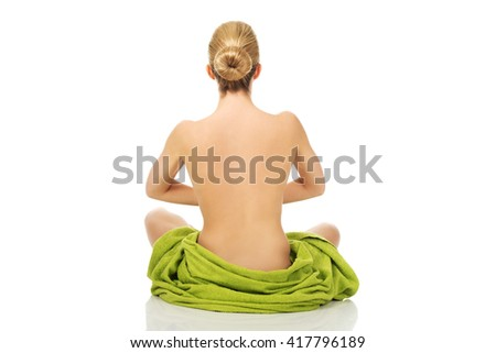 Young woman sitting in a yoga position - stock photo