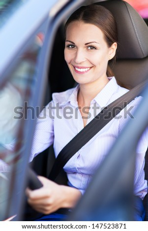 Young woman sitting in car - stock photo