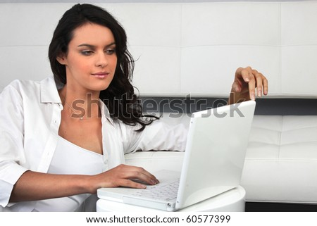 Young woman sitting in front of a laptop computer
