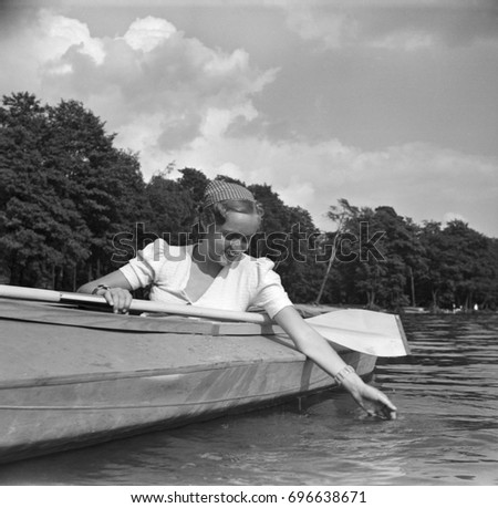 Young woman sitting in kayak