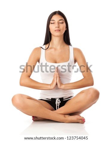 Young woman sitting in lotus position - stock photo