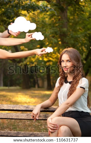 Young woman sitting on a bench and thinks