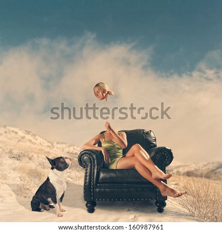 young woman sitting on a chair in the mountains - stock photo