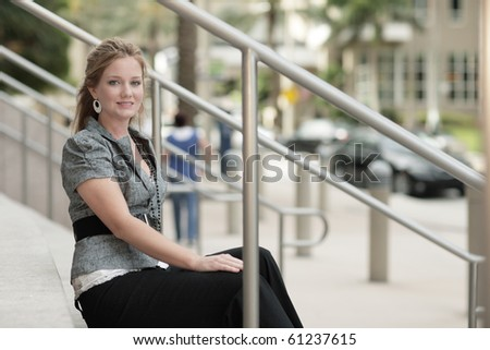 Young woman sitting on a staircase