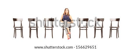 Young woman sitting on a wooden chair and waiting for job interview isolated on white background - stock photo