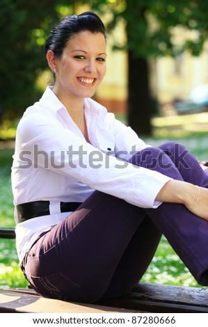 Young woman sitting on bench outdoor