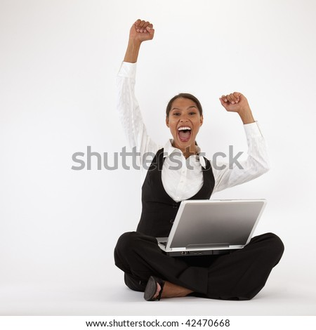 Young woman sitting on floor using laptop. Square format.