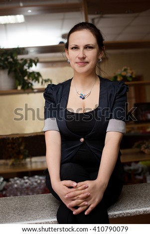 young woman sitting on the bar in the restaurant