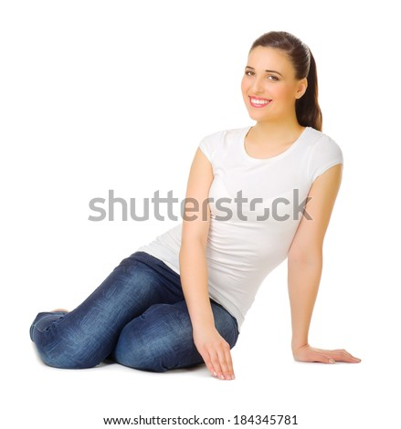 Young woman sitting on the floor isolated - stock photo