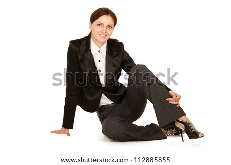 Young woman sitting on the floor , isolated on white background
