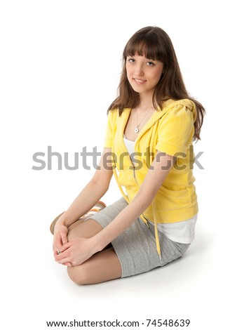 Young woman sitting on white - stock photo