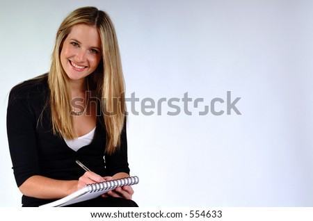 Young woman sitting ready to take notes.
